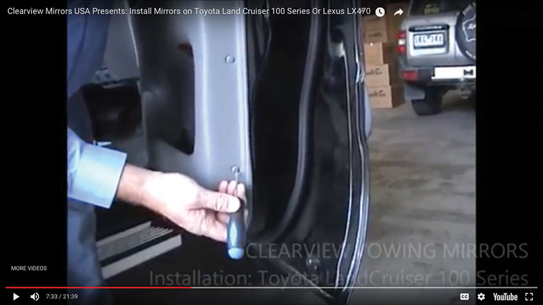 two plastic pins to the right outer section of the door panel